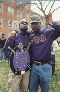 Geddis (left) poses with his dean, Lenny Lloyd (right), during his Spring 1996 probate initiating him as a member of Omega Psi Phi Fraternity, Inc., Alpha Chapter at Howard University. (Photo courtesy of La'Mont Geddis)