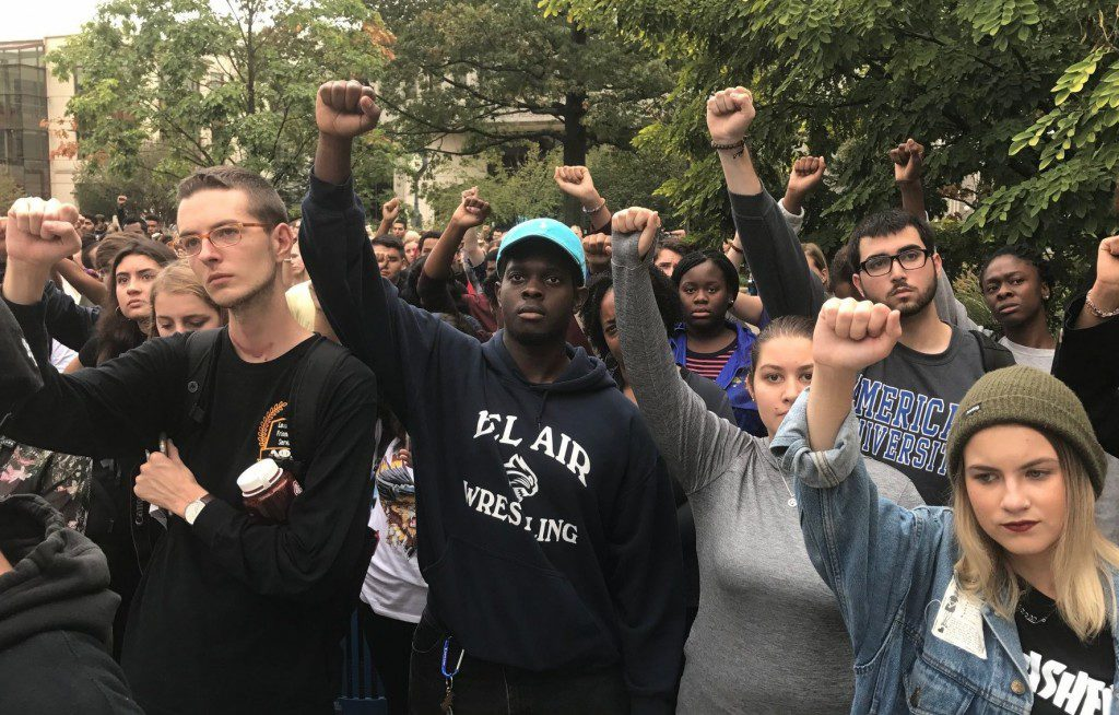 Students protest at American University on Monday, Sept. 19, following racist incidents at a student dorm, including one in which a banana was thrown at a black student. (Photo Credit: Alejandra Matos/The Washington Post)
