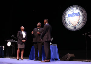 "Dr. Greg Carr, chair of Howard University's Afro-American Studies Department, flips a coin to determine who goes first during the 2016 AT&T Nation's Classic ""Game Before The Game"" #TheRealHUDebate at Cramton Auditorium, Friday, Sept. 16. (Photo Credit: Paul Holston, Editor-in-Chief/The Hilltop)"