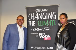 Founders of Vestige Strategies Quentin James and Stefanie Brown James stand Climate The Change Poster. (Photo by Jaylin Paschal)